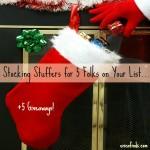 Santa placing some goddies in a Christmas stocking